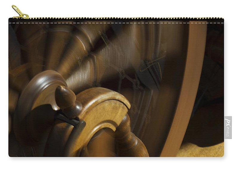 Spinning Wheel Carry-all Pouch featuring the photograph Let The Spinning Wheel Spin by Guy Shultz