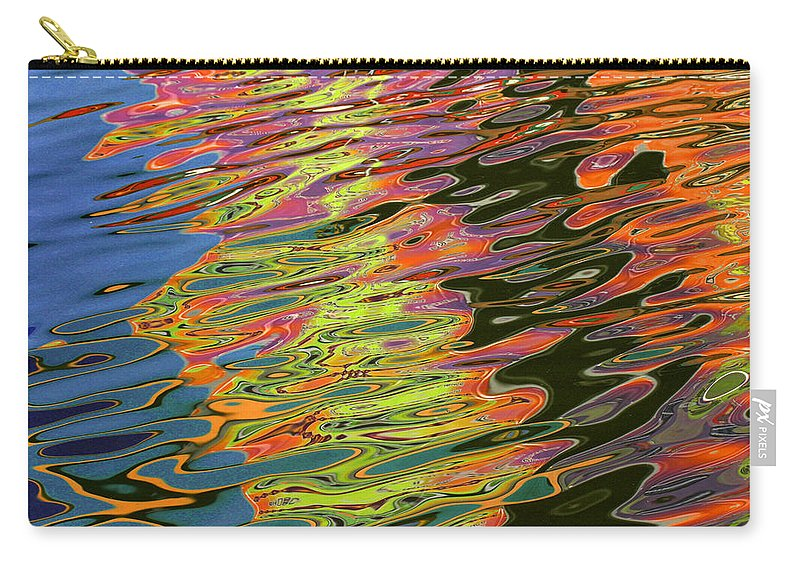 Reflections Carry-all Pouch featuring the photograph Light Reflections On The Water At Pleasure Island In Disney World by Randall Nyhof