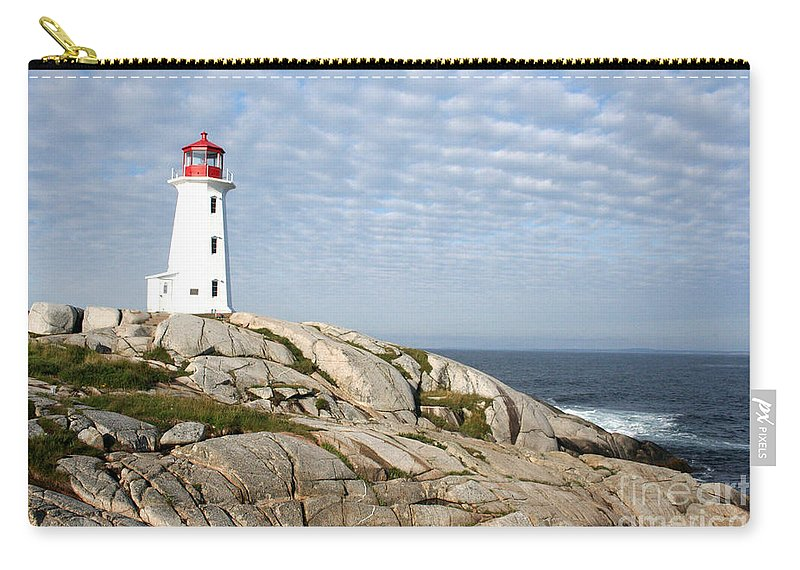 Lighthouse Carry-all Pouch featuring the photograph Lighthouse At Peggys Point Nova Scotia by Thomas Marchessault