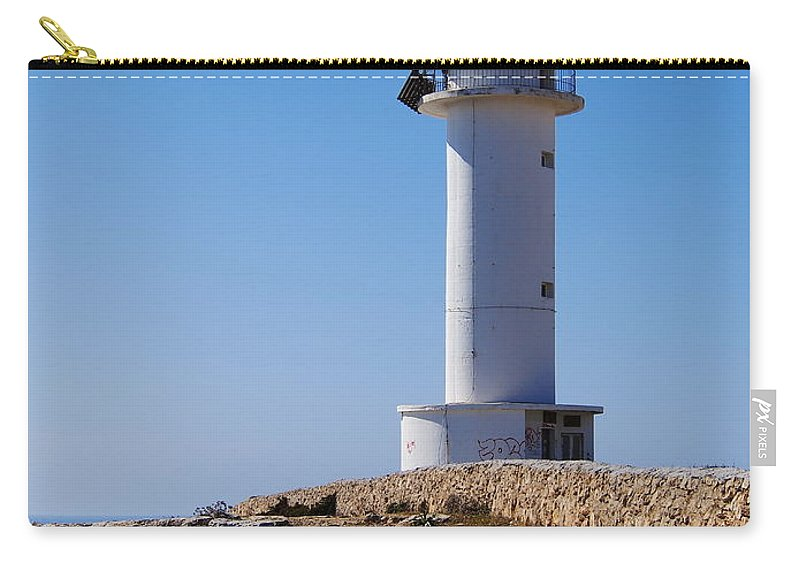 Landmark Carry-all Pouch featuring the photograph Lighthouse On Cap De Barbaria On Formentera by Karol Kozlowski