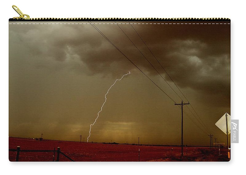 Lightning Carry-all Pouch featuring the photograph Lightning Strike In Oil Country by Ed Sweeney