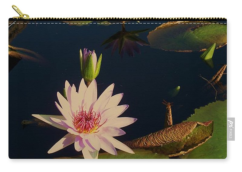 Photograph Carry-all Pouch featuring the photograph Lily White Monet by Eric Schiabor
