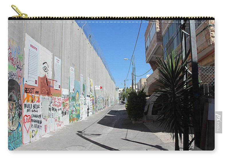 Apartheid Wall Carry-all Pouch featuring the photograph Living Next To Wall by Munir Alawi