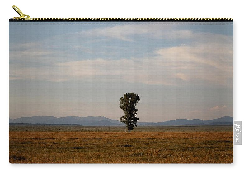 Kelly Carry-all Pouch featuring the photograph Lonely Tree by Catie Canetti