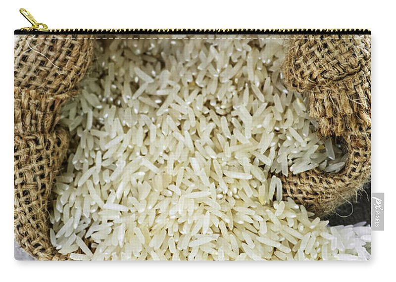 Rice Carry-all Pouch featuring the photograph Long Grain Rice In Burlap Sack by Elena Elisseeva
