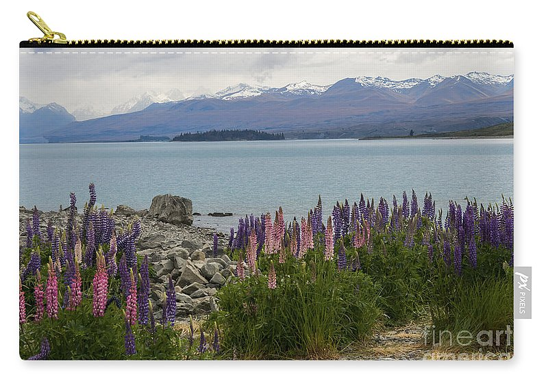 Lake Tekapo New Zealand Rock Rocks Mountain Mountains Lakes Lupin Lupins Flower Flowers Bloom Blooms Plant Plants Landscape Landscape Waterscape Waterscapes Mt. Mount Cook Carry-all Pouch featuring the photograph Lupins By Lake Tekapo by Bob Phillips