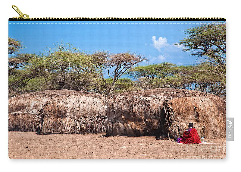 Maasai Carry-all Pouch featuring the photograph Maasai Huts In Their Village In Tanzania by Michal Bednarek