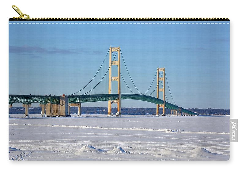 Mackinac Bridge Carry-all Pouch featuring the photograph Mackinac In March by Keith Stokes