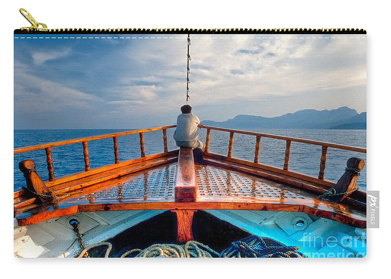 Aegean Carry-all Pouch featuring the photograph Man Day-deaming On Traditional Greek Ship by Stephan Pietzko