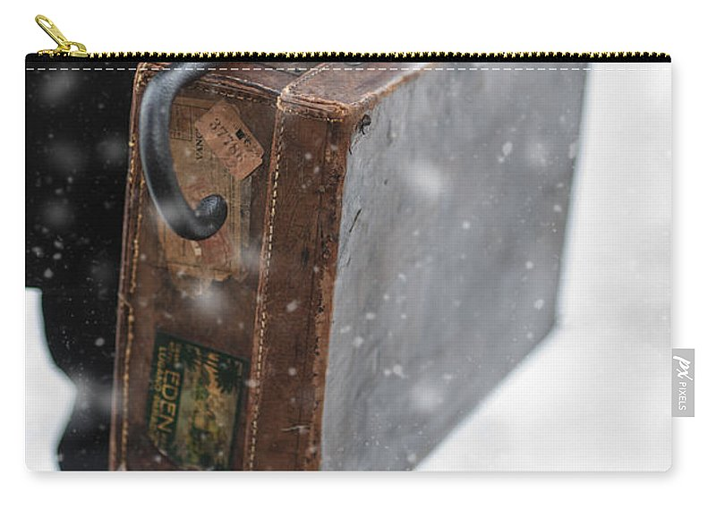 Suitcase Carry-all Pouch featuring the photograph Man Holding A Vintage Leather Suitcase In Winter Snow by Lee Avison