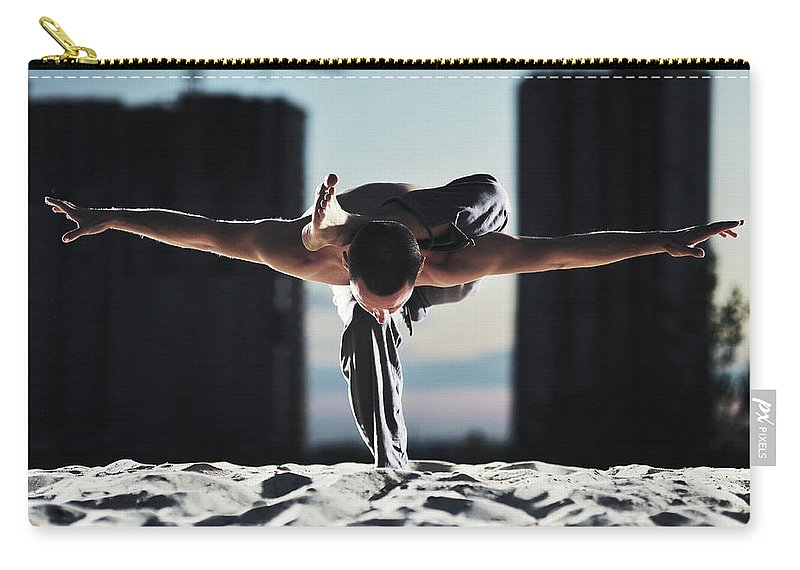 People Carry-all Pouch featuring the photograph Man Holding Yoga Pose In The Sand by Myshkovsky