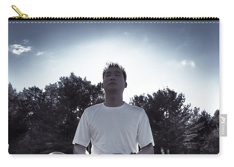 Meditation Carry-all Pouch featuring the photograph Man Meditating In The Nature During Sunrise by Oleksiy Maksymenko