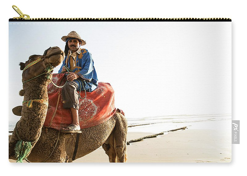 Agadir Carry-all Pouch featuring the photograph Man On Camel On Beach, Taghazout by Tim E White