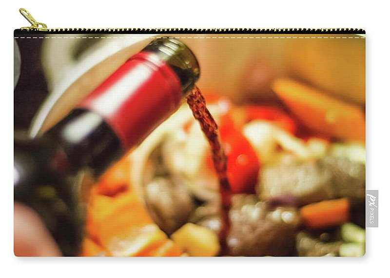 Mature Adult Carry-all Pouch featuring the photograph Man Pouring Wine Into Vegetables by Manuel Sulzer