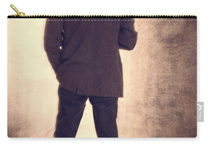 Grunge Carry-all Pouch featuring the photograph Man With Vintage Umbrella by Edward Fielding
