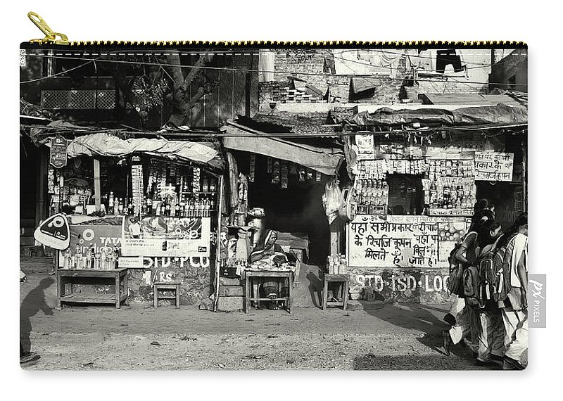 Travel Carry-all Pouch featuring the photograph Man Woman And Schoolgirls by Roberto Pagani