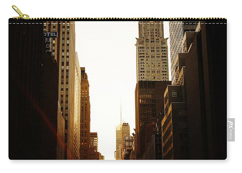 New York City Carry-all Pouch featuring the photograph Manhattanhenge Sunset And The Chrysler Building by Vivienne Gucwa