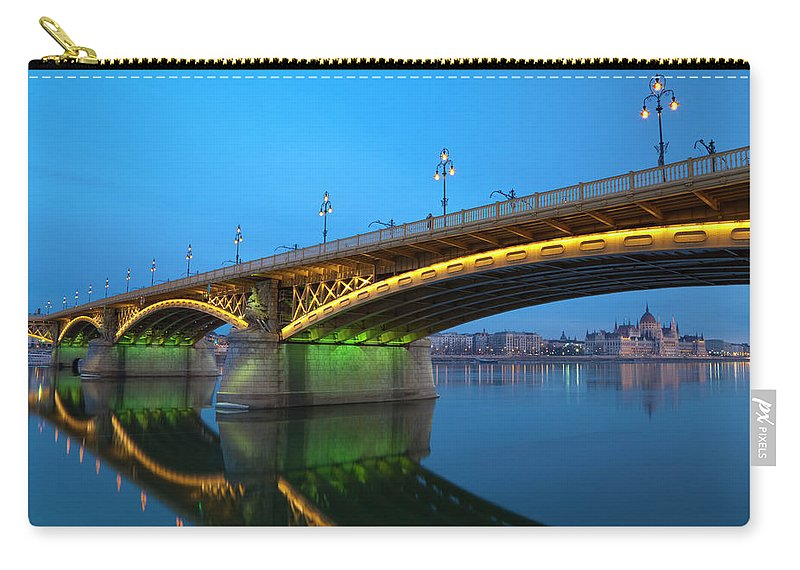 Town Carry-all Pouch featuring the photograph Margaret Bridge And The Parliament by Focusstock