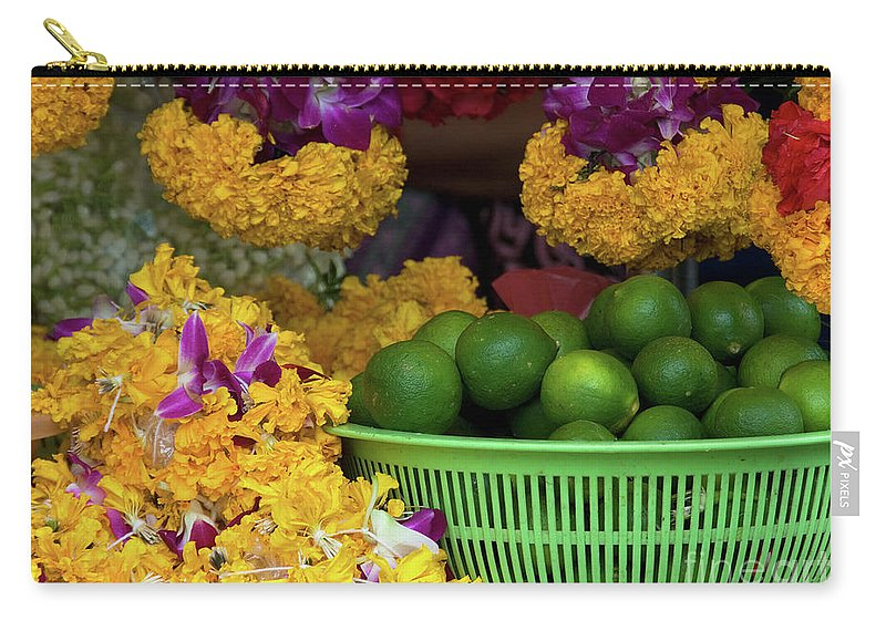 Lime Carry-all Pouch featuring the photograph Marigolds And Limes by Rick Piper Photography