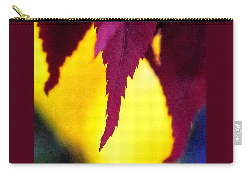 Maroon Carry-all Pouch featuring the photograph Maroon And Yellow by Ian MacDonald