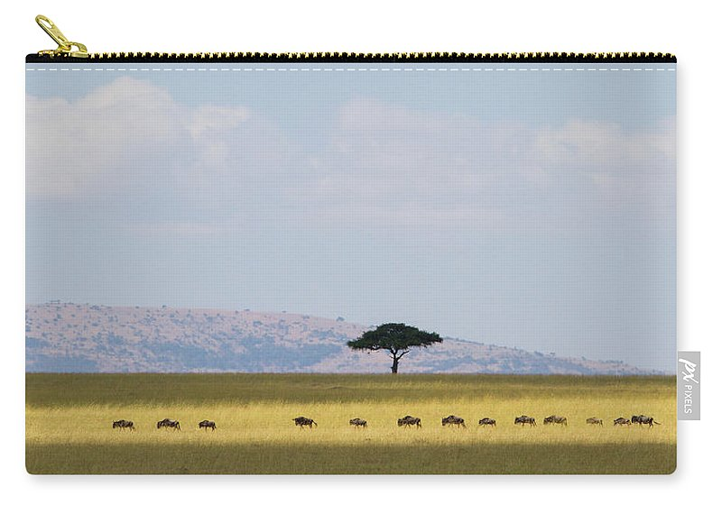 Kenya Carry-all Pouch featuring the photograph Masai Mara Wildebeest Migration by Universal Stopping Point Photography