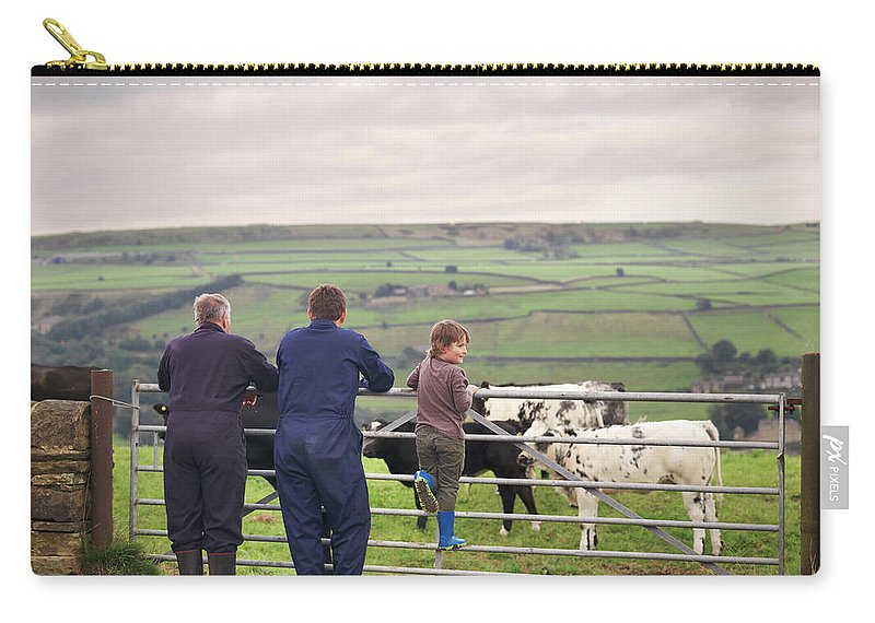 Mature Adult Carry-all Pouch featuring the photograph Mature Farmer, Adult Son And Grandson by Monty Rakusen