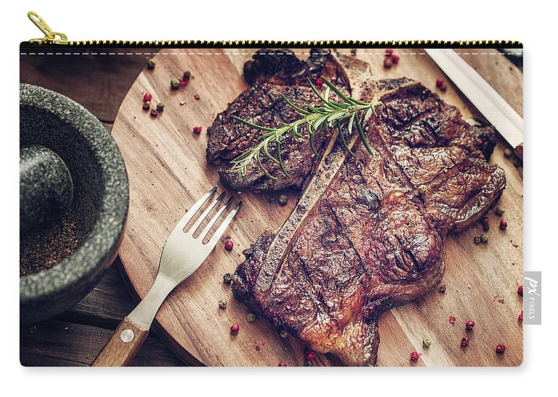 Rosemary Carry-all Pouch featuring the photograph Medium Roasted T-bone Steak by Gmvozd