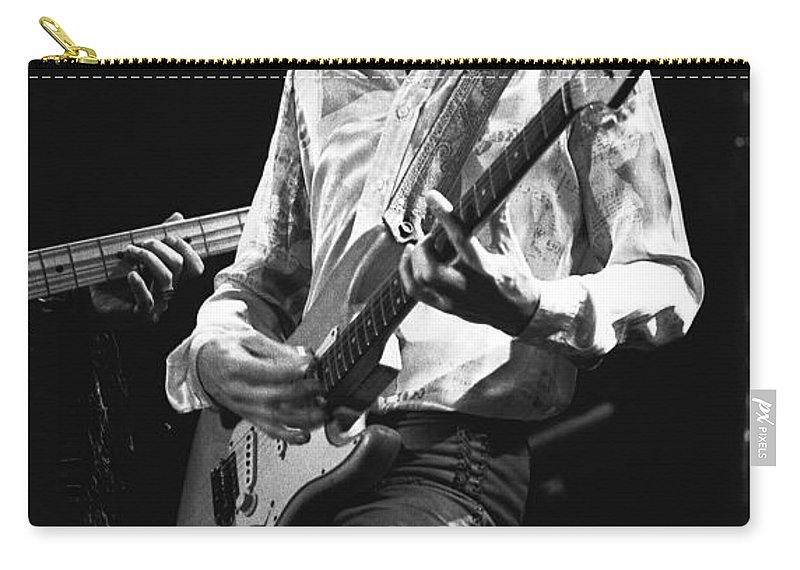 Mick Ralphs Carry-all Pouch featuring the photograph Mick In Flight 1977 by Ben Upham