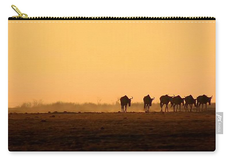 Wildebeests Carry-all Pouch featuring the photograph Migration by Amanda Stadther