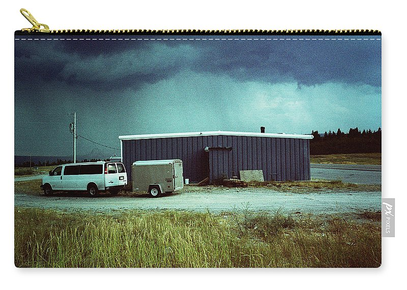 Babb Carry-all Pouch featuring the photograph Montana Rain by Jennifer Ann Henry
