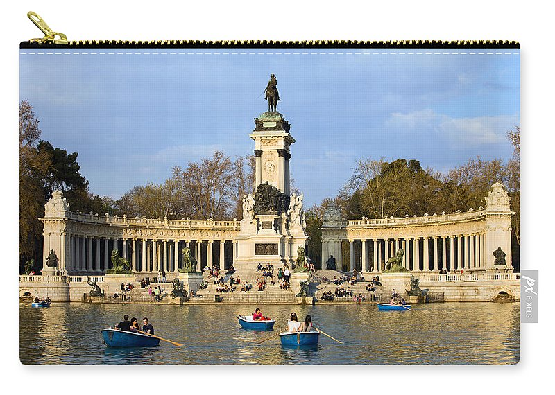 Madrid Carry-all Pouch featuring the photograph Monument And Lake In Retiro Park In Madrid by Artur Bogacki
