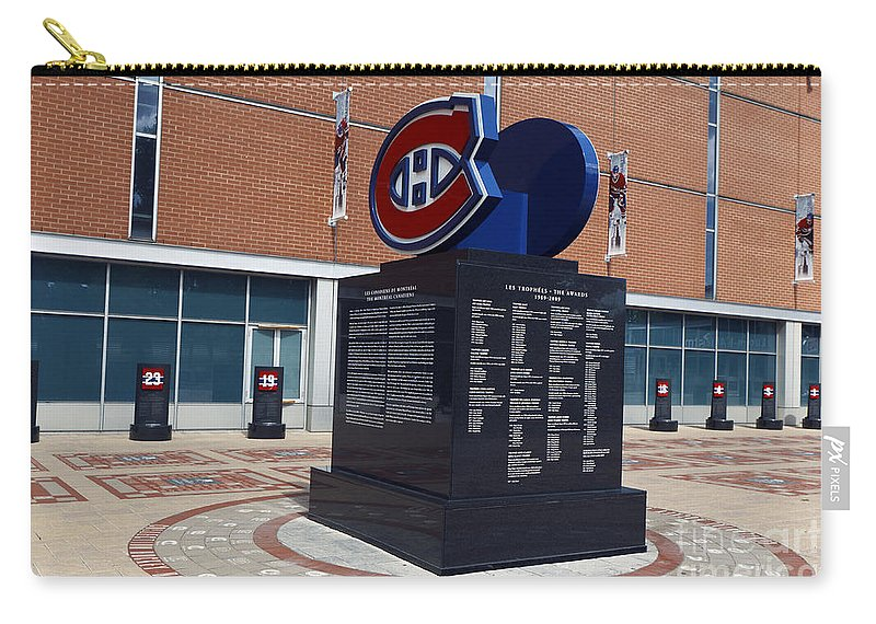 Travel Carry-all Pouch featuring the photograph Monument For The Montreal Canadiens by Jason O Watson