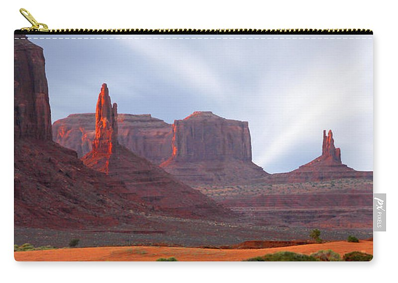 Desert Carry-all Pouch featuring the photograph Monument Valley At Sunset Panoramic by Mike McGlothlen