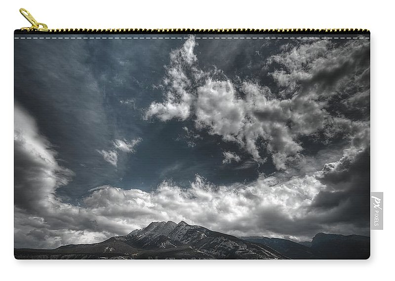 Sky Carry-all Pouch featuring the photograph Moody Blue by Wayne Sherriff