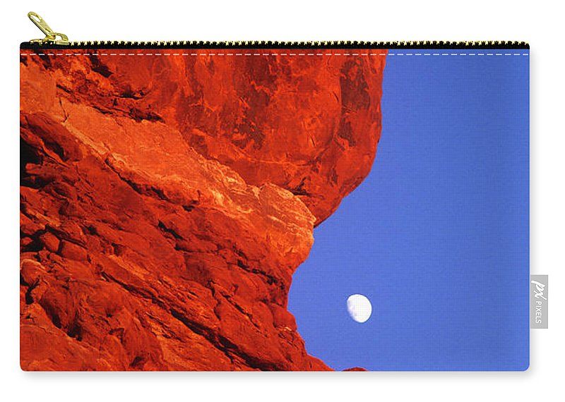 North America Carry-all Pouch featuring the photograph Moonrise Balanced Rock Arches National Park Utah by Dave Welling