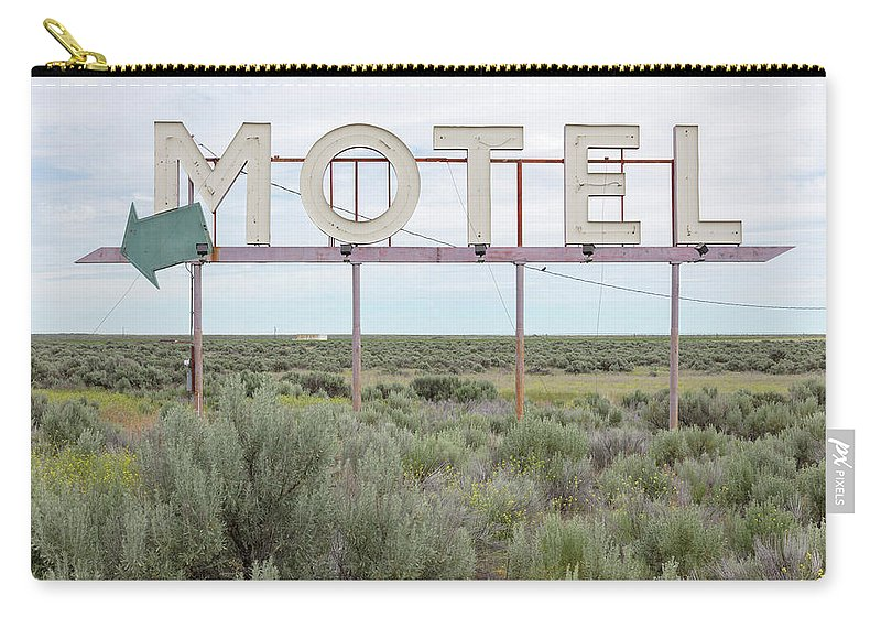 Grass Carry-all Pouch featuring the photograph Motel Sign In Field Of Sage Brush, Out by Mint Images
