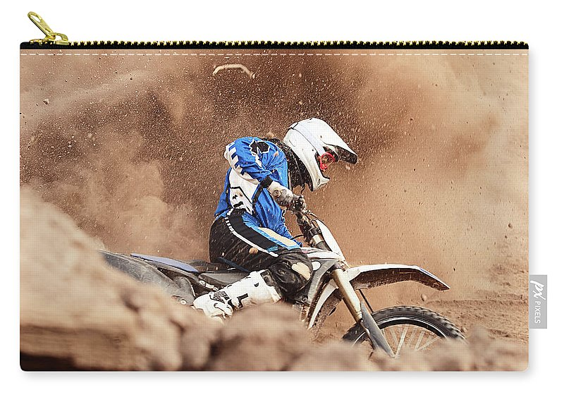 Crash Helmet Carry-all Pouch featuring the photograph Motocross Biker Taking A Turn In The by Daniel Milchev