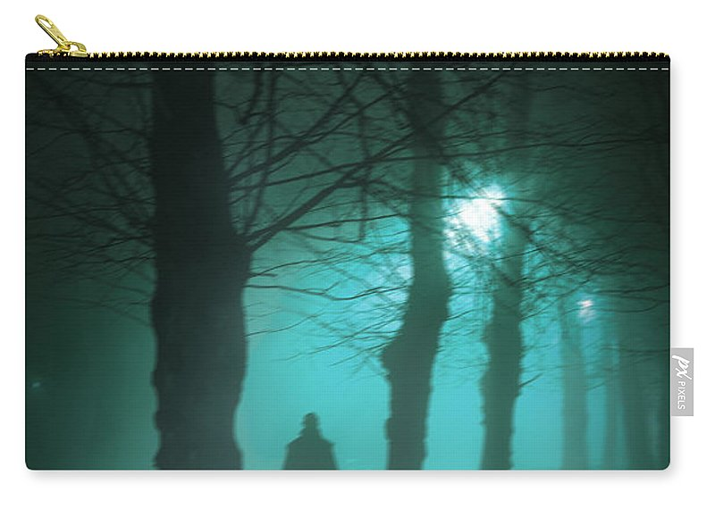 Man Carry-all Pouch featuring the photograph Mysterious Man In A Foggy Forest by Lee Avison