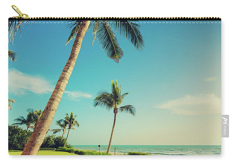 Vacations Carry-all Pouch featuring the photograph Naple Beach Palms by Thepalmer
