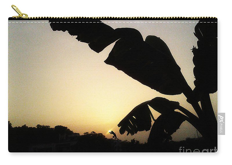 Rest House Carry-all Pouch featuring the photograph Never Let You Go Sun by Artist Nandika Dutt