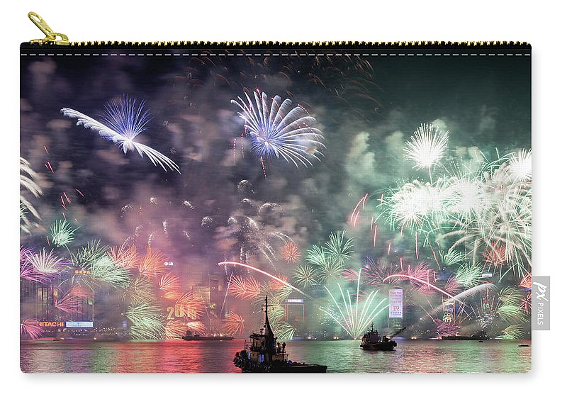 Firework Display Carry-all Pouch featuring the photograph New Year Fireworks Hong Kong Asia by Steffen Schnur