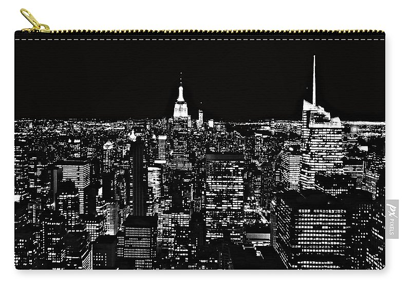 New York City Skyline At Night Carry-all Pouch featuring the photograph New York City Skyline At Night by Dan Sproul