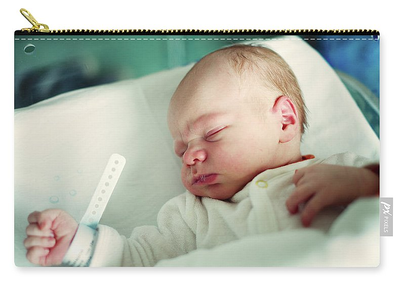 Tranquility Carry-all Pouch featuring the photograph Newborn Boy. First Day by Aleksandr Morozov