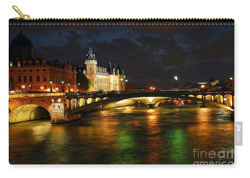 Architecture Carry-all Pouch featuring the photograph Nighttime Paris by Elena Elisseeva