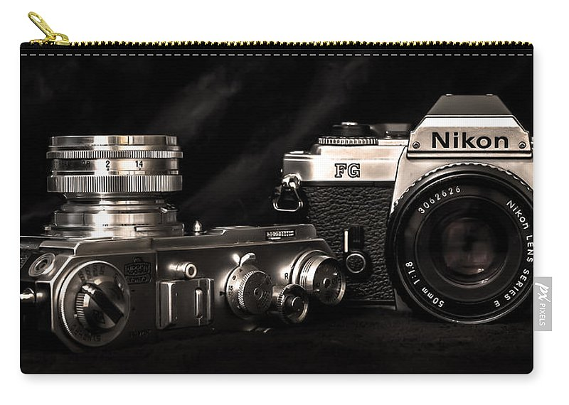 Nikon Cameras Carry-all Pouch featuring the photograph Nikon by Curtis Cabana