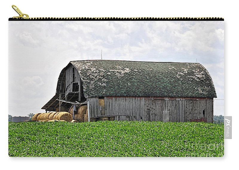 Barn Carry-all Pouch featuring the photograph Old Barn And Round Bales by David Arment
