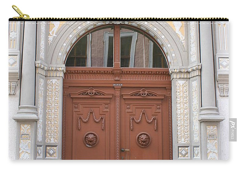 Door Carry-all Pouch featuring the photograph Old Entrance Door With Lionheads by Christiane Schulze Art And Photography