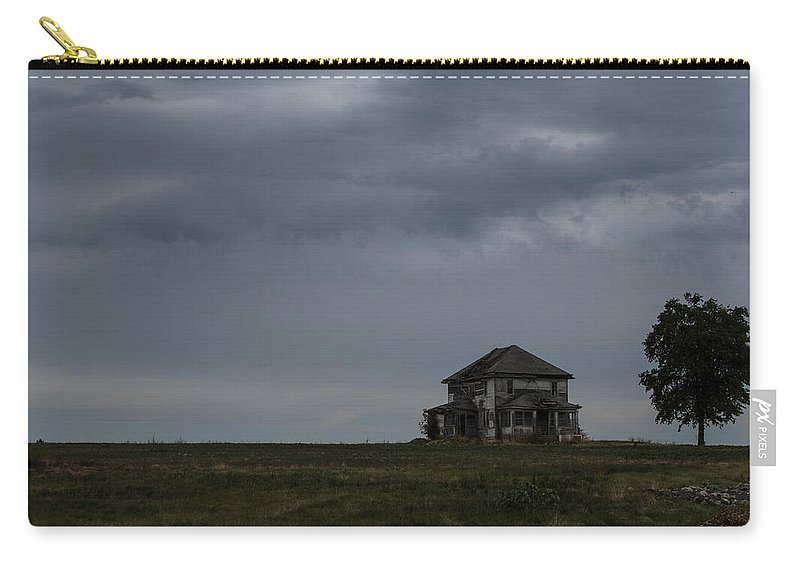 Storm Carry-all Pouch featuring the photograph Old House On The Prairie by Guy Shultz