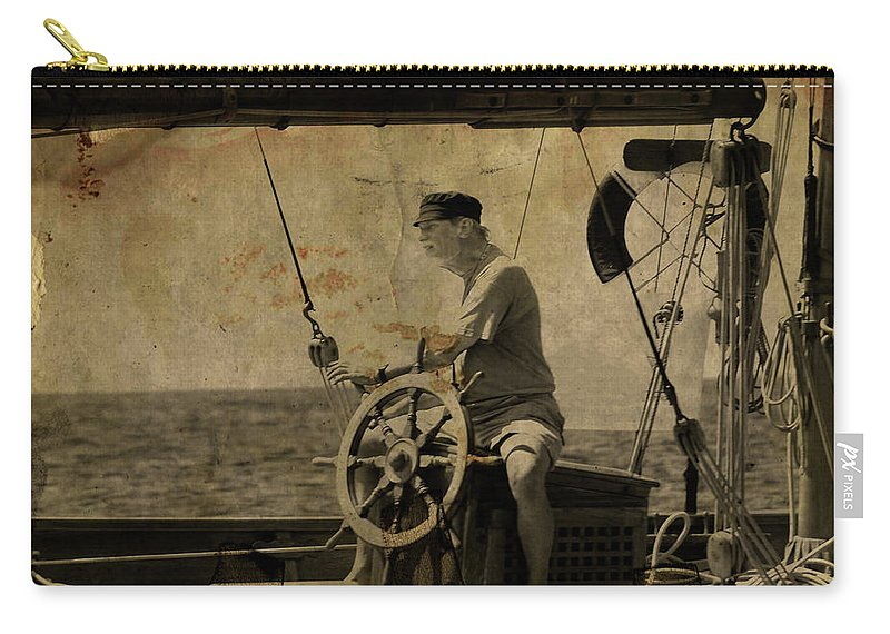 Tall Ship Carry-all Pouch featuring the photograph old sailor A vintage processed photo of a sailor sitted behind the rudder in Mediterranean sailing by Pedro Cardona Llambias