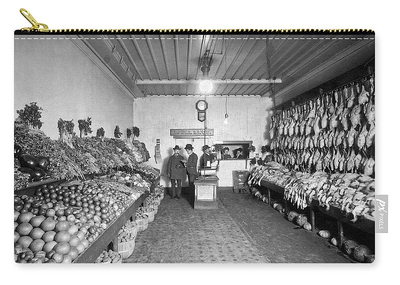1035-1098 Carry-all Pouch featuring the photograph Old Time Grocery Store by Underwood Archives
